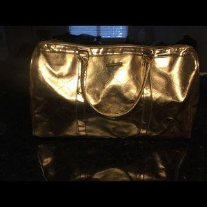 BCBGMaxAzria Bags - Gold BCBG travel bag